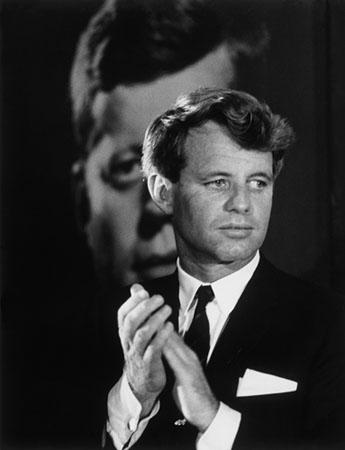 Robert F. Kennedy in front of a poster of his brother, Columbus, Ohio, 1968<br/>