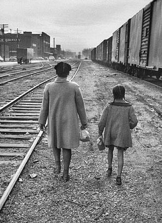 Brown Sisters Walk to School, Topeka, Kansas, 1953. Photograph by Carl Iwasaki<br/>