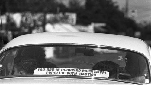 A sign in rear window of car in Philadelphia, Mississippi:<br/>