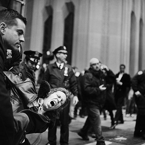 An Occupy Wall Street demonstrator is arrested on Broadway and Wall Street on November 17, 2011 Archival C Print