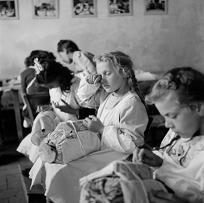 """Tired Eyes"". Orphans in a sewing class, Trieste, Italy, 1947 Gelatin Silver print"