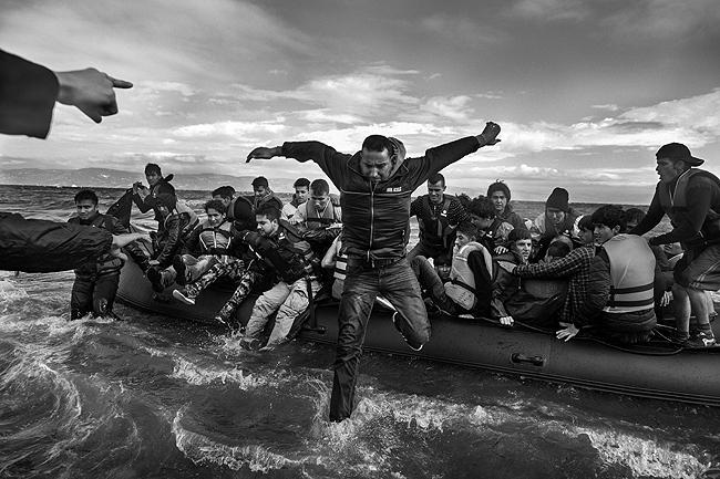 Refugees, primarily from Syria, Iraq and Afghanistan, disembark on the island of Lesvos, Greece, 2015 Archival Pigment Print