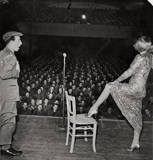 Marlene Dietrich posing seductively as she exhibits her famous leg while entertaining troops in Germany, February, 1945<br/>