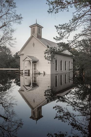 A church flooded by Hurricane Florence stands silently in its reflection in Burgaw, North Carolina, 2018<br/>