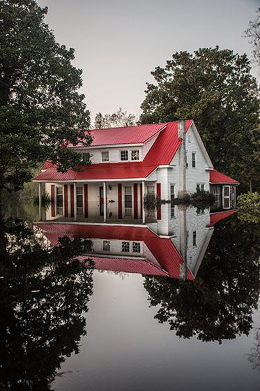 A local pastor's home, which succumbed to flood waters in Burgaw, North Carolina.<br/>