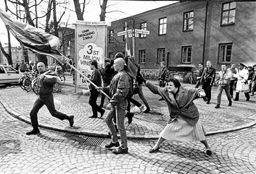 A woman hitting a neo-Nazi with her handbag, Växjö, Sweden, 1985 Archival Pigment Print