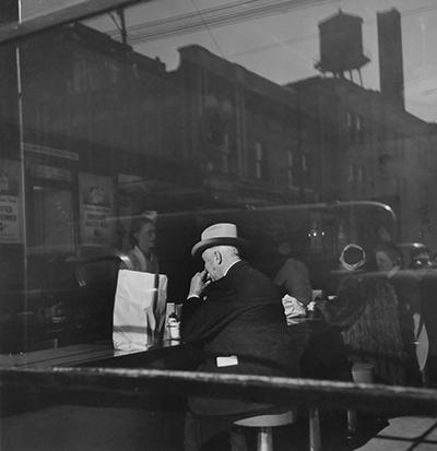 A quick bite at the Glorified Hamburger, Chicago, IL,  1946 Gelatin Silver print