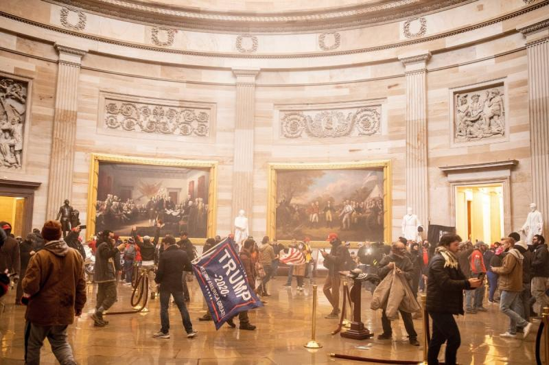 A mixture of tear gas discharged by police and fire-extinguisher residue discharged by pro-Trump extremists hung in the air of the Rotunda as the crowd milled about, 238 p.m., January 6, 2021 Archival Pigment Print