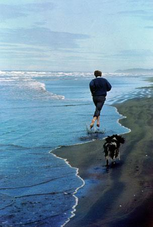 Presidential candidate Bobby Kennedy and his dog, Freckles, running on an Oregon beach, 1968 (cover of Life Magazine, June 14, 1968)<br/>