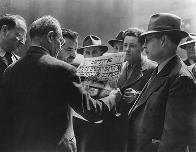 Men of the Garment District Read of President Roosevelt's Death, NYC, 1945<br/>