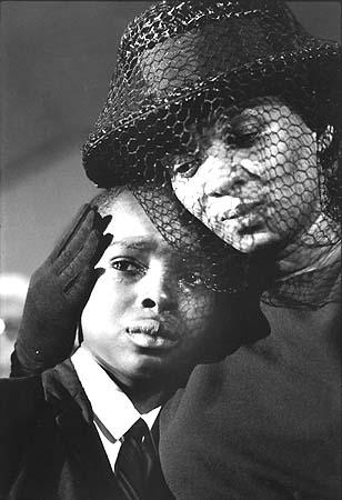 Mrs. Chaney and young Ben, James Chaney funeral, Meridian, Mississippi, 1964<br/>