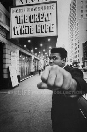 "Boxing champion Muhammad Ali  posing in front of the Alvin Theater during production of play ""The Great White Hope"", NY, 1968 Gelatin Silver print"