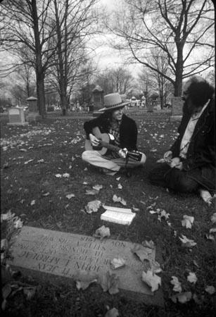 Bob Dylan and Allen Ginsberg at Jack Kerouac's grave, Lowell, MA, 1975<br/>