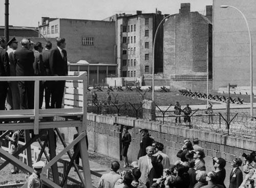 President John F. Kennedy looking over  Berlin wall to Eastern Sector, 1963<br/>